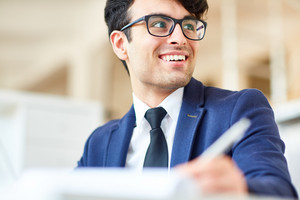 Successful young businessman listening to colleague during conversation