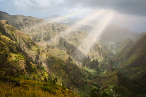Sun rays coming through the clouds in rocky mountain landscape of in Xo-xo valley in Santo Antao island, Cape Verde
