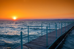Sunset over lake Balaton, Hungary, Europe. Pier on the lake