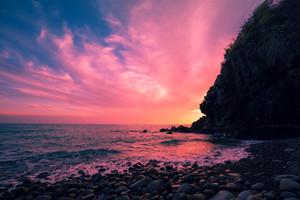 Sunset over rocky sea coast
