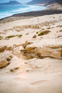 Surreal sand rocky stone in the dune on the Atlantic coastline on Baia Das Gatas. North of Calhau, Sao Vicente Island Cape Verde