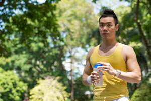 Sweaty man drinking after running