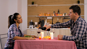 Sweet couple having a romantic dinner at home. Happy couple