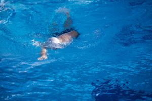 swimmer excercise on indoor swimming pool, sport and health concept