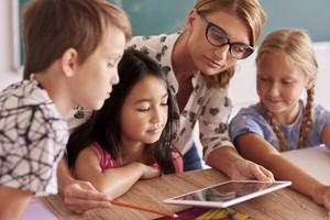 Teacher explaining to pupils new things