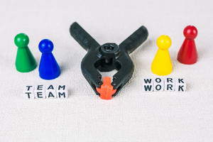 Team work concept - Figures form with clamp tool as symbol for a working labor team collaboration