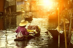 thai fruit seller sailing wooden boat in thailand tradition floating market