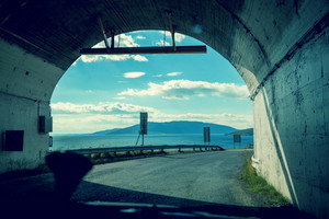 The end of the tunnel. Driving a car on a mountain road