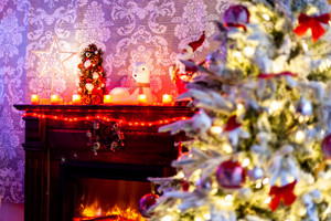 The joy of Christmas near the warmth of fireplace. Christmas decoration.