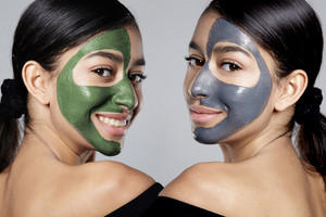 the same woman in double portrait with half of face with facial mask