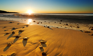 The sun sets over a beautiful Australian beach