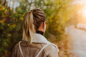 Thoughtful woman looking throught the window. Raindrops, Rainly street, golden autumn, sunlight