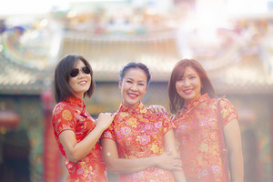 three asian woman smiling face standing against blur background of chinese thrine in bangkok thailand