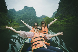 three asian woman tourist sailing in ninh binh canal one of most popular traveling destination in vietnam