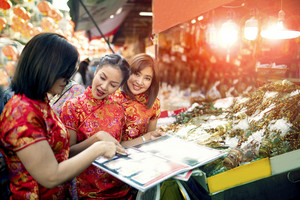 three asian woman wearing chinese tradition clothes happiness touring in yaowarat road one most popular traveling and famous street food in bangkok thailand
