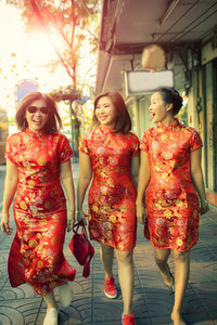 three asian woman wearing chinese tradition clothes happiness with self confidence walking in china town bangkok thailand