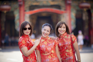 three asian woman wearing chinese tradition clothes in yaowarat street bangkok thailand