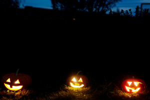 Three jack-or-lanterns burning in Halloween night