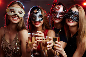 Toasting girls in carnival masks enjoying party