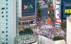 TOKYO, JAPAN - SEPTEMBER 25, 2017: Pedestrians cross the Shibuya Scramble crosswalk, one of the busiest intersections in the world.