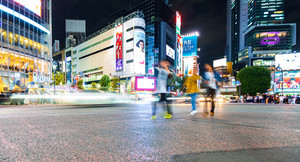 TOKYO, JAPAN - SEPTEMBER 25, 2017: People cross the Shibuya Scramble crosswalk, one of the busiest intersections in the world.