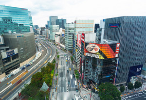 TOKYO, JAPAN - SEPTEMBER 26, 2017: People and traffic cross a busy intersection in Ginza Tokyo Japan