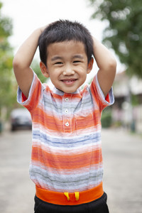 toothy smiling face happiness emotion of asian children standing outdoor