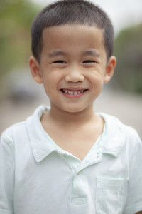 toothy smiling face of asian children happiness emotion face