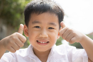 toothy smiling face of asian children happiness emotion