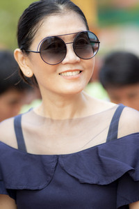 toothy smiling face of beautiful asian woman happiness emotion