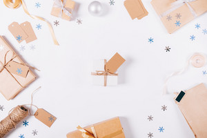 Top view Christmas decorations and boxes with gifts on a white table