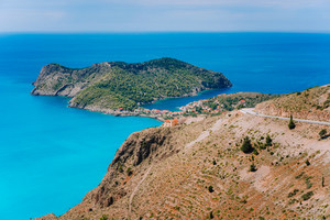 Top view of Assos village located in cute bay on beautiful blue sea coastline, Kefalonia island, Greece