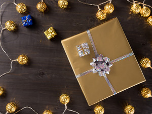 Top view of golden christmas gift boxes on old vintage wooden background. Winter celebration