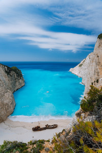 Top view of Navagio Shipwreck Beach on Zakynthos island, Greece. Famous attraction landmark must-see place visit in summer vacation