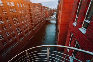 Top view of Warehouse District from canal side with red brick buildings of Speicherstadt in Hamburg during sunset