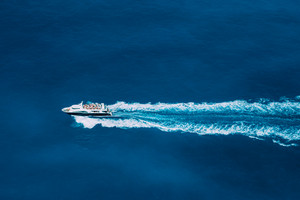 Tourist boat in full speed in open sea, Greece