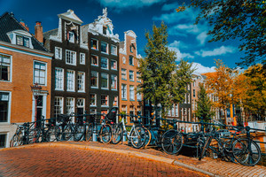 Traditional Dutch style houses in Amsterdam, Netherlands. Vibrant autumn day