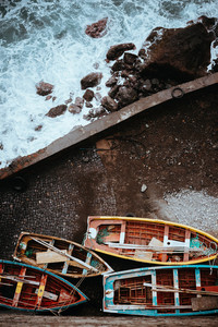 Traditional fishing boats in the harbor. View from above, view top-down. Ponta do Sol Santo Antao Cape Verde