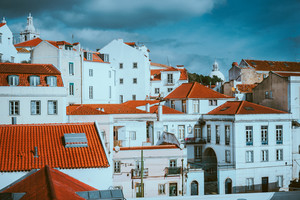 Traditional red and white scenery of Lisbon. Historical downtown built on the side of the hill