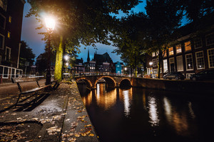 Tranquil scene of Amsterdam, autumn cityscape of beautiful bridge over canal. the Netherlands. Long exposure
