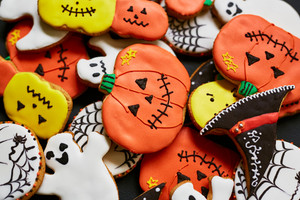 Trick-or-treat cookies in form of pumpkin, ghost and hat