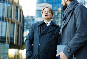 Two business leaders interacting in urban environment