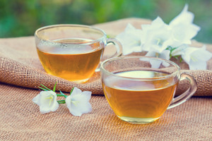 Two cups of herbal tea in the garden