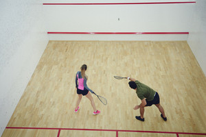 Two friends playing squash together