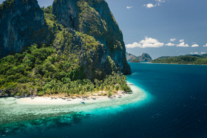 Unique beauty of tropical Pinagbuyutan Island and white sand ipil beach in blue ocean El Nido, Palawan, Philippines. Aerial view