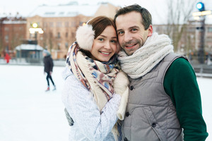 Urban couple in winterwear embracing outdoors