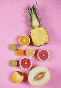 Various halved exotic fruits at studio shot