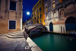 Venetian street in the night, Italy