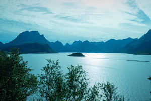 View at the fjord. Rocky beach. Beautiful nature Norway. Lofoten islands. Blue colored. Mountain landscape in evening