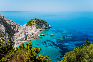 View to Agia Eleni beach in Kefalonia Island, Greece. Most beautiful rocky wild beaches with clear emerald water and high white cliffs